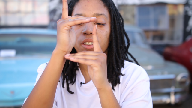 "Jasmine Haynes, AKA TurferGirl, ""finger tutting,"" a key element of Turfin', a hip-hop dance style that originated in Oakland. (Jeremy Raff/KQED)"