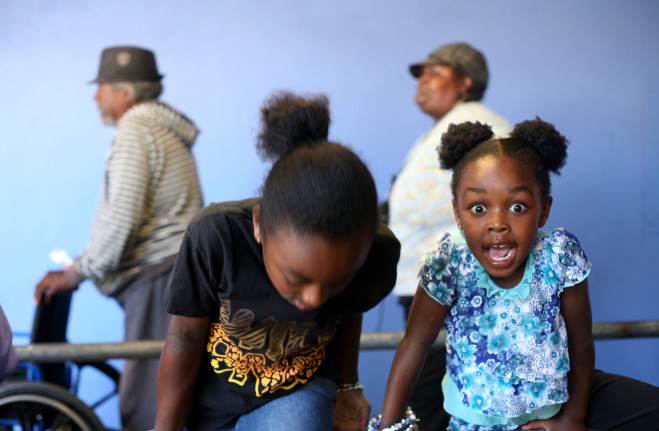 Oakland children wait in line at the St. Vincent de Paul meal program. (Anna Vignet/Oakland Local)