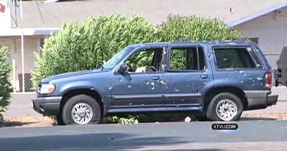 Screen capture from KTVU video showing vehicle that carried Stockton bank robbery suspects and hostages during a chase and gun battle with police.
