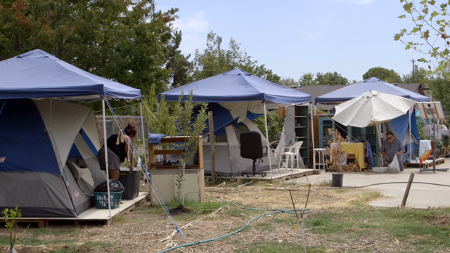 There are around ten residents living at Fresno's Dakota Eco Garden. (Adam Grossberg/KQED)