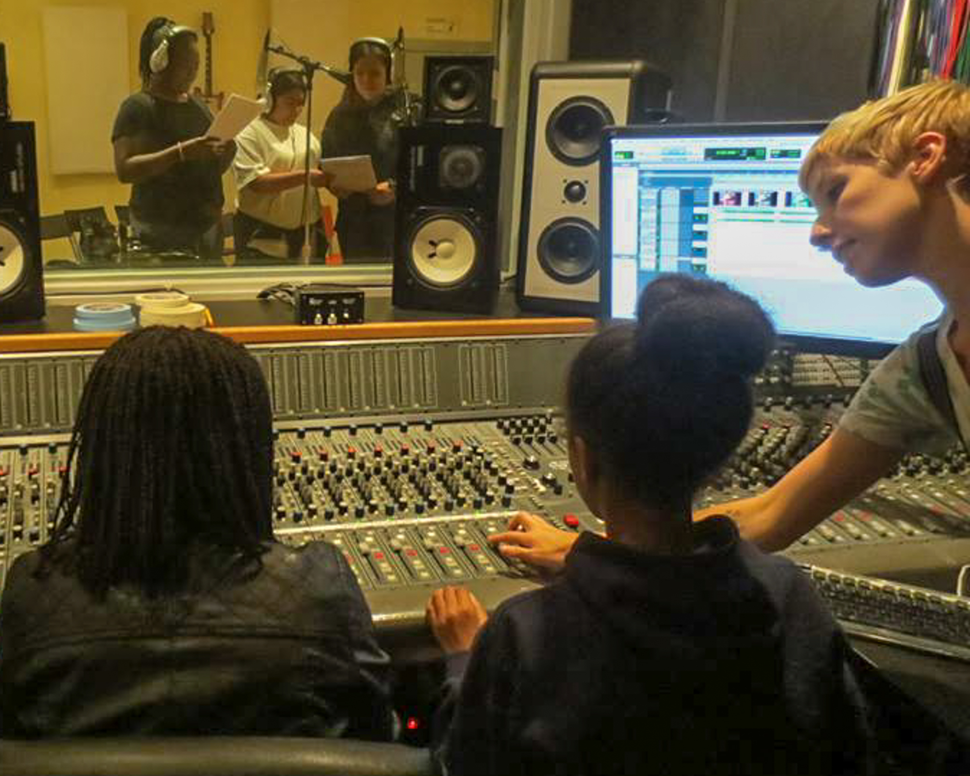 An instructional session in a control room at San Francisco's Women's Audio Mission. (Courtesy Women's Audio Mission)