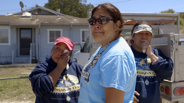Three Drakes Bay Oyster Company workers react to  the deconstruction of the company's canning and retail operations, on July 31st, 2014. (Adam Grossberg/KQED)