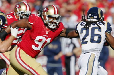 San Francisco 49ers defensive tackle Ray McDonald, wearing No. 91, in action in 2012. (Brian Bahr/Getty Images)