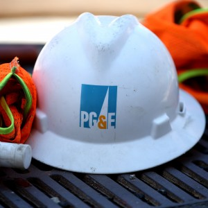 The PG&E logo is displayed on a hard hat at a work site earlier this summer. (Justin Sullivan/Getty Images)