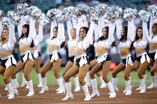 The Raiderettes, the Oakland Raiders cheerleaders, perform during the Oakland Raiders preseason game against the Detroit Lions at O.co Coliseum on August 15, 2014 in Oakland, California. (Ezra Shaw/Getty Images)