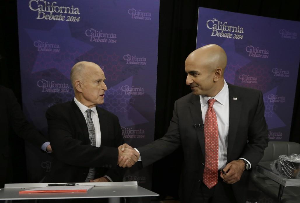 Gov. JerryBrown, left, shakes hands with Republican challenger Neel Kashkari before a gubernatorial debate in Sacramento, Calif., Thursday, Sept. 4, 2014. (AP Photo/Rich Pedroncelli, Pool)