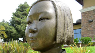 """A group of residents is suing the city of Glendale over its statue honoring """"comfort women"""" of the World War II era. The bronze statue was created by artist Bok Lim Kim. (Susan Valot/KQED)"""