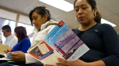 Students at Orange County's Mexican consulate study the California Driver Handbook. With AB-60, California joins 10 other states in allowing undocumented immigrants to apply for driver's licenses. (Marcus Teply/KQED)