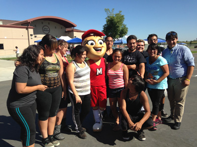 Shelly Pistacio with members of the Modesto High Band at the Wood Colony Country Fair. (Lisa Morehouse/KQED)