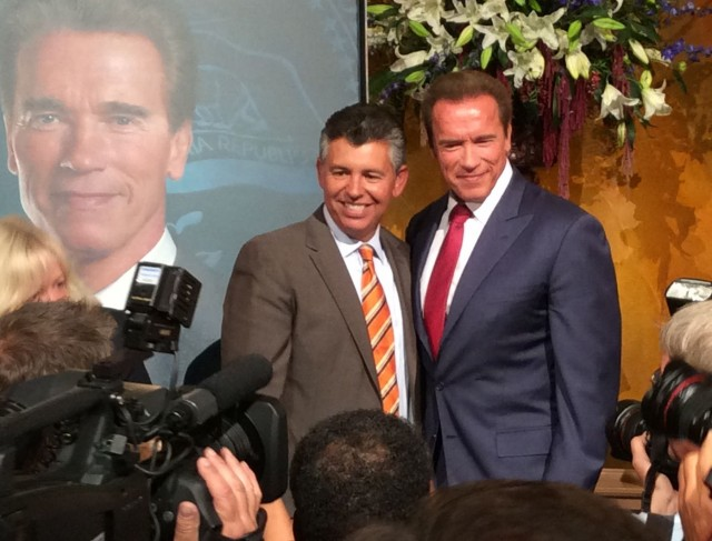 Former Gov. Arnold Schwarzenegger poses with former Lt. Gov. Abel Maldonado at the unveiling of Schwarzenegger's portrait. (Photo: John Myers/KQED)