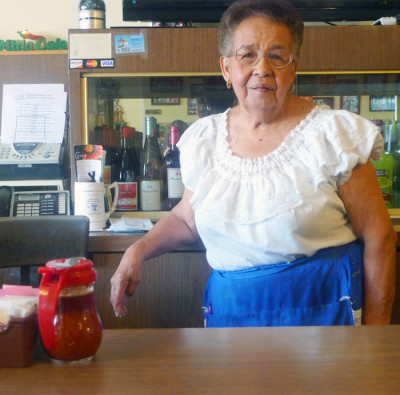 Waitress Lucy Reyes started working at Mitla Cafe in 1951. (Lisa Morehouse/KQED)