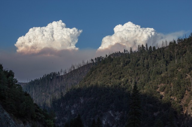 The Happy Camp Complex wildfire, burning in the mountains south of the Klamath River in Siskiyou County, as seen from Highway 96 east of the town of Happy Camp last Thursday.  (Dan Brekke/KQED)