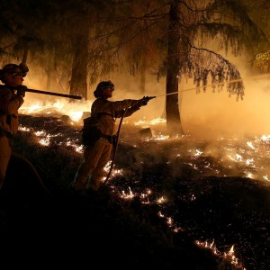 Firefighters monitor battle the King Fire near the town of Pollock Pines earlier this week. ( Justin Sullivan/Getty Images)