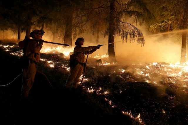 Firefighters monitor battle the King Fire near the town of Pollock Pines earlier this week. (Justin Sullivan/Getty Images)