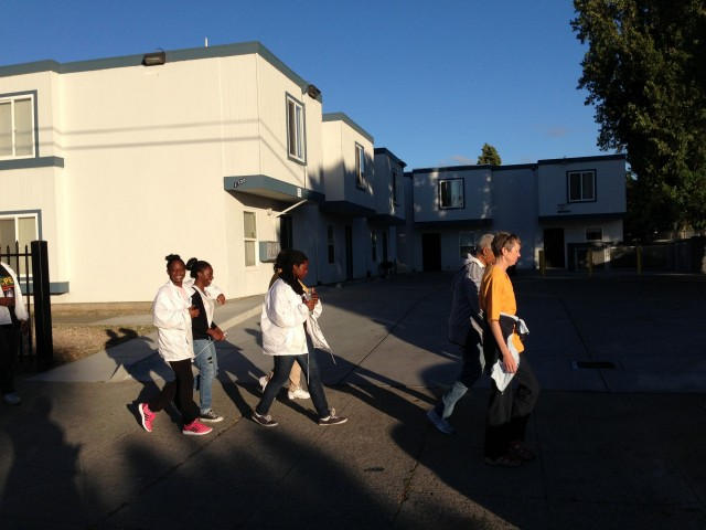 A peace march goes through East Oakland every Friday evening. (Cyrus Musiker/KQED)