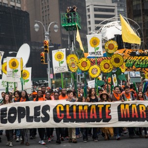 People protest for greater action against climate change during the People's Climate March on September 21, 2014 in New York City. The march, which calls for drastic political and economic changes to slow global warming, has been organized by a coalition of unions, activists, politicians and scientists.  (Andrew Burton/Getty Images)