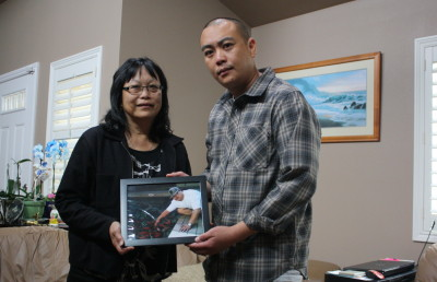 Christine Goias and Matt Chang hold a photo of Errol Chang, who was killed by Daly City SWAT officers in March. (Alex Emslie/KQED)""
