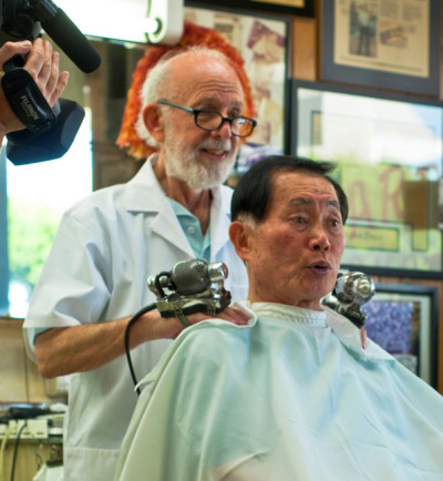 """George Takei gets a massage from his barber (and childhood friend) Jerry Cottone. (Patrick Siemer/""""To Be Takei"""")"""