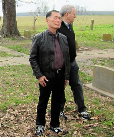 """George and Brad Takei on a pilgrimage at the cemetery at Rohwer Relocation Center in Arkansas, where the Takei family was imprisoned during World War II. (Cinematographer Chris Million/""""To Be Takei"""")"""