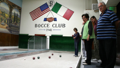 Joseph Lencioni (right) and other members of San Mateo's Peninsula Italian American Social Club during weekly bocce league play. (Vanessa Rancaño/KQED)