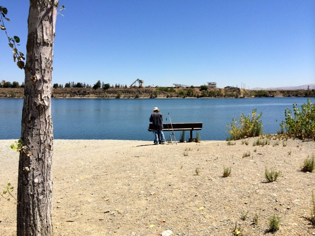 "Fishing is a popular pastime at Shadow Cliffs. Tony Soleta, pictured, says ""the lake needs some more water."" (Aaron Mendelson/KQED)"