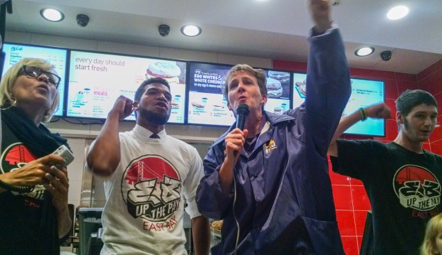 SEIU President Mary Kay Henry and fast-food workers occupy a North Oakland McDonalds earlier this month. (Andrew Stelzer/KQED)