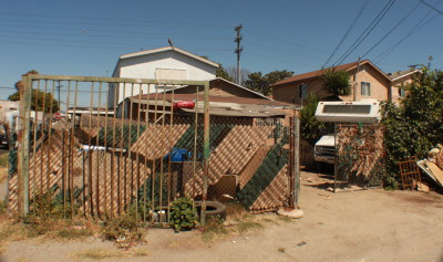 A new state law could make it easier to remove trespassers from homes like this one in South L.A. where squatters apparently moved in after the house was foreclosed on (Steven Cuevas/KQED)