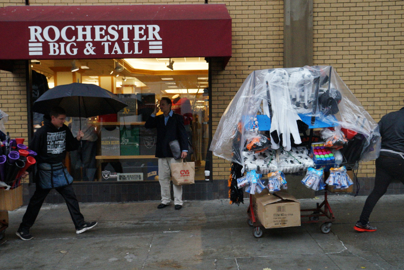 Street vendors began making their way to Market St. for the Giants Parade early in the morning. (James Tensuan/KQED)