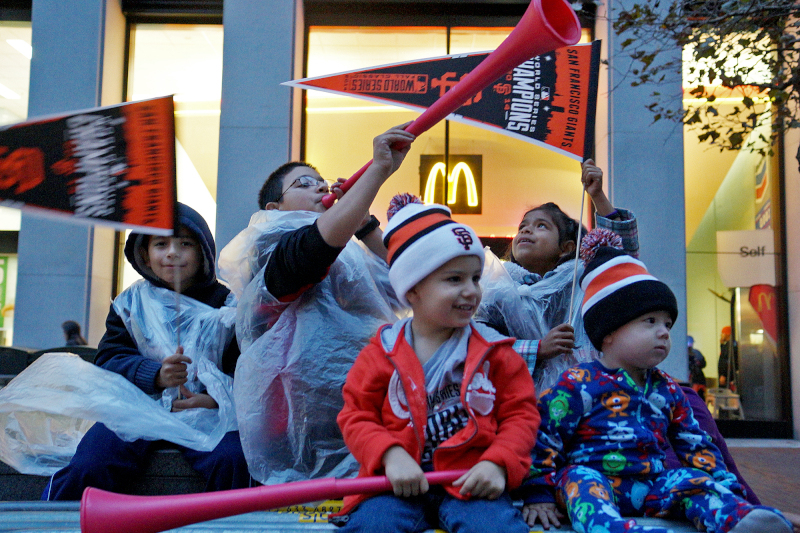 Rear left to right: Antonio, Carlos and Jissel Zermeno and LJ and William Martinez prepare for the Giants Parade on Market St. in San Francisco, Calif. on Friday, Oct. 31, 2014. The Zermenos drove hours to attend their first ever Giants parade. (James Tensuan/KQED)