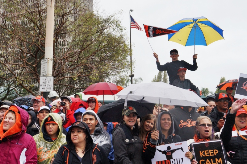 Despite the rain, hundreds of thousands of fans came out to see the parade. (James Tensuan/KQED)