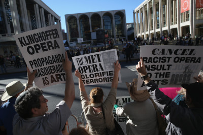 Demonstrators outside the Metropolitan Opera in New York to protest the staging of Berkeley composer John Adams's The Death of Klinghoffer. (John Moore/Getty Images)