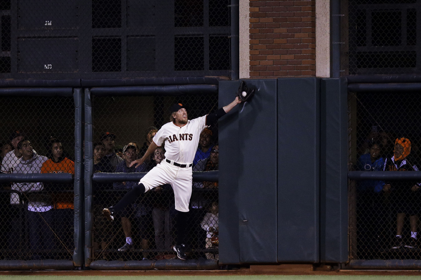 San Francisco Giants right fielder Hunter Pence makes a leaping catch in game four of the National League Division Series. The Giants won the game against the Washington Nationals 3-2 to advance to the National League Championship Series. (Ezra Shaw/Getty Images)