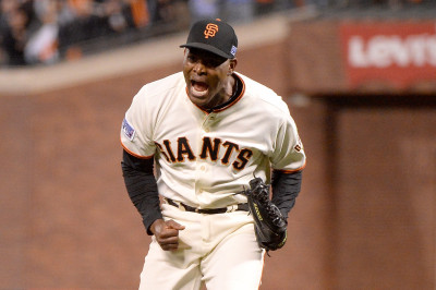Santiago Casilla, closer of the San Francisco Giants reacts after getting the final out in the ninth inning against the St. Louis Cardinals during Game Four of the National League Championship Series at AT&T Park on October 15, 2014 in San Francisco,.(Harry How/Getty Images)