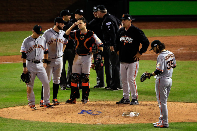 Bruce Bochy #15 of the San Francisco Giants stands on the mound during a pitching change against the Kansas City Royals in the sixth inning during Game Two of the 2014 World Series at Kauffman Stadium on October 22, 2014 in Kansas City, Missouri. (Photo by Rob Carr/Getty Images)