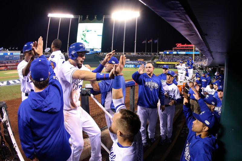Eric Hosmer returns to the dugout after scoring in the sixth inning. (Elsa/Getty Images)