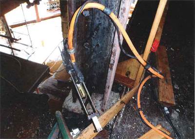 """A stud welding gun at the """"area of origin"""" of the Renoir Hotel Fire, """"removed from floor and hung on studs,"""" according to the the fire department. (San Francisco Fire Department)"""