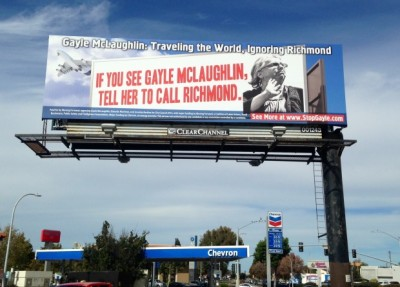An anti-McLaughlin billboard, funded by Chevron, looms over San Pablo Avenue, criticizing her travel history. (Brett Murphy/Richmond Confidential)