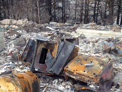 Many homes burned by the Boles Fire were fully leveled, with only the blackened husks of metal appliances left recognizable. (Daniel Potter/KQED)