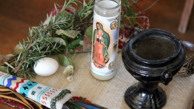 The limpia, or traditional cleansing ceremony, is designed to restore emotional health. It requires a raw egg, fresh herbs and a vase for burning copal, an aromatic tree resin from central Mexico. (Sara Bernard/KQED)