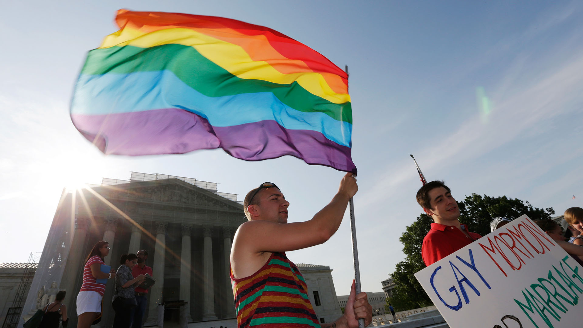 Gay rights supporter Vin Testa waves a rainbow flag outside the U.S. Supreme Court building on June 26, 2013.