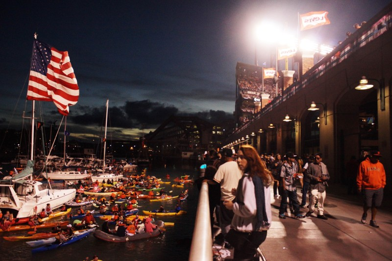Fans gather outside McCovey Cove to watch game three of the World Series. (James Tensuan/KQED)