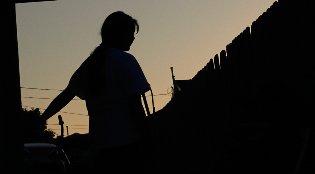 At dusk in Los Angeles, Maria, 15, waits for word on her plea for asylum.