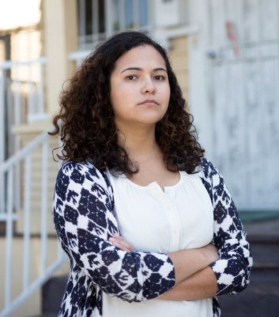 Los Angeles attorney Patricia Ortiz, 30, of the Esperanza Immigrant Rights Project, shoulders the lead on dozens of U.S. asylum requests from minors fleeing organized-crime violence in Central America. (Annie Tritt/Center for Public Integrity)