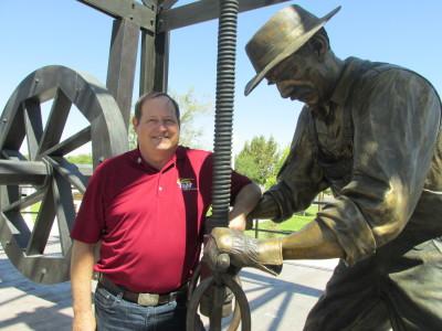 Taft Mayor Pro Tem Orchel Krier with the town's Oil Worker Monument. (Scott Shafer/KQED)