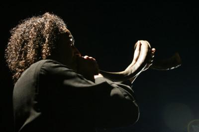 A person blows the shofar. (Ziv Koren/Getty Images)
