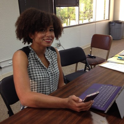 Courtney Cooper of Los Gatos can't vote for Rep. Mike Honda, but she can volunteer to work the phones. (Rachael Myrow/KQED)
