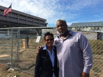 Elaine Brown and Jerry Elster stand at the future site of an urban farm in West Oakland. (Mina Kim/KQED)