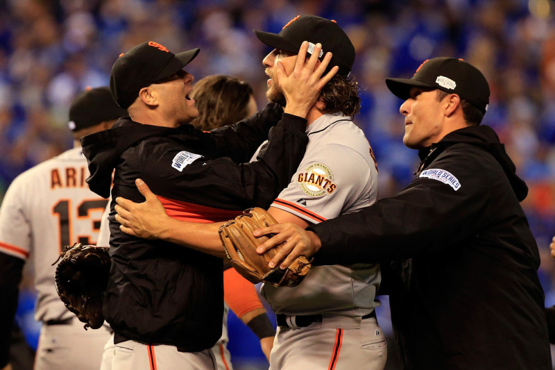Tim Hudson #17 celebrates with Madison Bumgarner #40 on the field after defeating the Kansas City Royals 3-2 to win Game Seven of the 2014 World Series. (Jamie Squire/Getty Images)