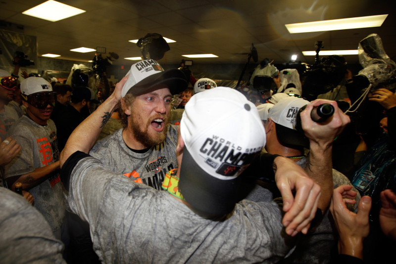 Hunter Pence of the San Francisco Giants celebrates with teammates in the locker room after defeating the Kansas City Royals in the World Series. (Ezra Shaw/Getty Images)