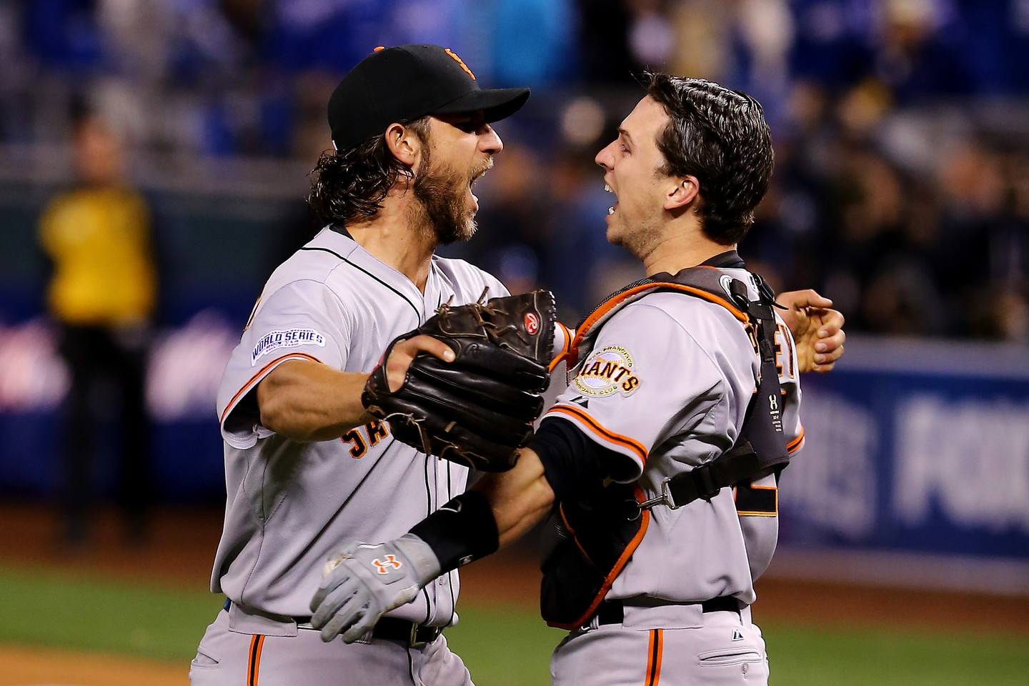Buster Posey #28 and Madison Bumgarner #40 of the San Francisco Giants celebrate after defeating the Kansas City Royals to win Game Seven of the 2014 World Series. (Photo by Elsa/Getty Images)